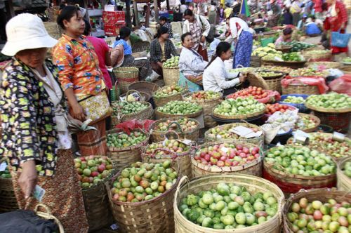 Tomato vendors wait for customers at a local bazaar in Dawei, about 380 miles (615 kilometers) south of Yangon, Burma.