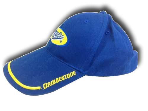 หมวก,ของพรีเมี่ยม,ของที่ระลึก,ของขวัญปีใหม่,ของที่ระลึกเกษียณอายุราชการ,ของที่ระลึกงานศพ ของขวัญแจกพนักงานหมวก BRIDGESTONE หมวกสีล้วน สีน้ำเงิน โลโก้สีเหลือง 2 ตำแหน่ง