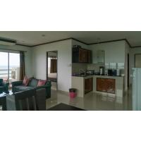 Spacious, furnished luxury beach condo for sale at New World Condos on Mae Rumphueng Beach in Rayong, Thailand.
