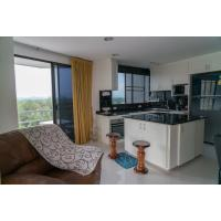 Luxury beach condo with sea and forest views for sale at The Royal Rayong on Mae Rumphueng Beach in Thailand