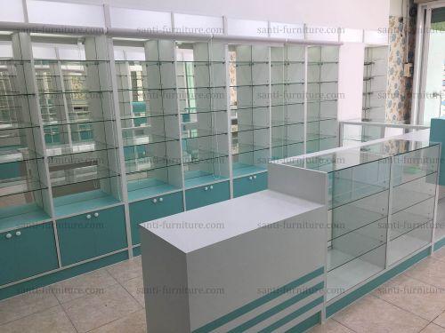 ตู้ยา ชั้นวางยา ตกแต่งร้านขายยา อคิลิค กล่องไฟ ม่านม้วน ตะขอแขวนสินค้า กระจกเงา เคาน์เตอร์ ตู้กระจก เฟอร์นิเจอร์ตามสั่ง