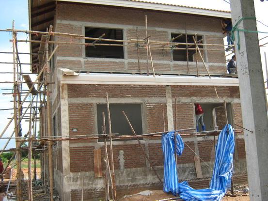 ตีลายก่ออิฐสร้างบ้าน