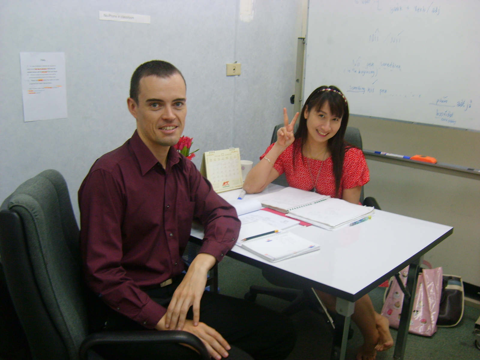 Thai teacher with student who work at UN Thailand